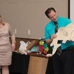 JOHN URBANICK RECEIVED SEVERAL GOING-AWAY GIFTS FROM HIS COLLEAGUES.