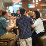 STUDENTS ATTENDING ORIENTATION ENJOY A FREE LUNCH AT A CAMPUS DINING FACILITY.