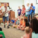 ACCLAIMED CHILDREN'S MUSICIAN GUY LOUIS PERFORMED.