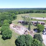 AERIAL VIEWS OF DEMOLITION ACTIVITY ON THE MAIN CAMPUS.