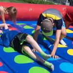CHILDREN ENJOYED INFLATABLE TWISTER FUN AT THE SIZZLIN' SUMMER LUAU.