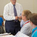 PROVOST PAUL BLAKE CHATS WITH NEW FACULTY.