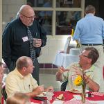 ASSOCIATE PROVOST BILL POTTER VISITS WITH FACULTY.