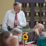 PRESIDENT DAVID EISLER GREETS FACULTY AT THE WELCOME BACK PICNIC.