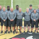 PRESENTING THE BULLDOG FOOTBALL COACHES AND SUPPORT STAFF. . .