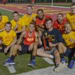 THE MEN'S VARSITY TRACK TEAM TOOK FIRST PLACE AT THE HOMECOMING KICKBALL TOURNAMENT.