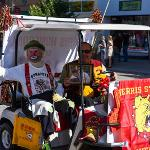 DYNAMITE THE CLOWN AND REX SCHUBERG SHARE THEIR ALLEGIANCE TO THEIR ALMA MATER.