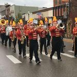 THE DELTA OMEGA CHAPTER OF THE KAPPA KAPPA BAND FRATERNITY ORGANIZED A VOLUNTEER MARCHING BAND.