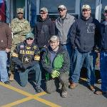 A GROUP OF VETERANS POSE DURING VETERANS APPRECIATION DAY AT TOP TAGGART FIELD.