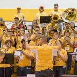 PRESIDENT DAVID EISLER JOINS THE FSU PEP BAND AT THE VOLLEYBALL MATCH AGAINST GRAND VALLEY.
