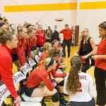 HEAD COACH TIA BRANDEL-WILHELM SETS UP THE STRATEGY FOR THE BULLDOGS.