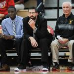 THE BULLDOG COACHING STAFF OBSERVES THE ACTION AT WINK ARENA.