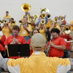 THE BULLDOG PEP BAND SHOWS ITS SUPPORT.