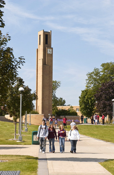 Students walking by the bell tower