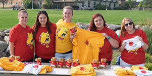 A group of students share their school pride with Ferris apparel
