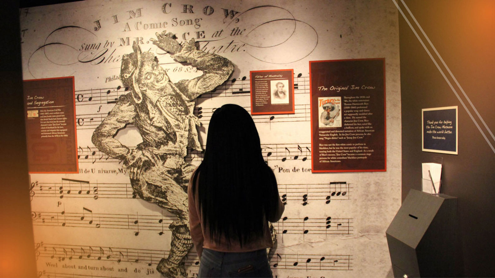 Visitor viewing exhibit at Jim Crow Musuem