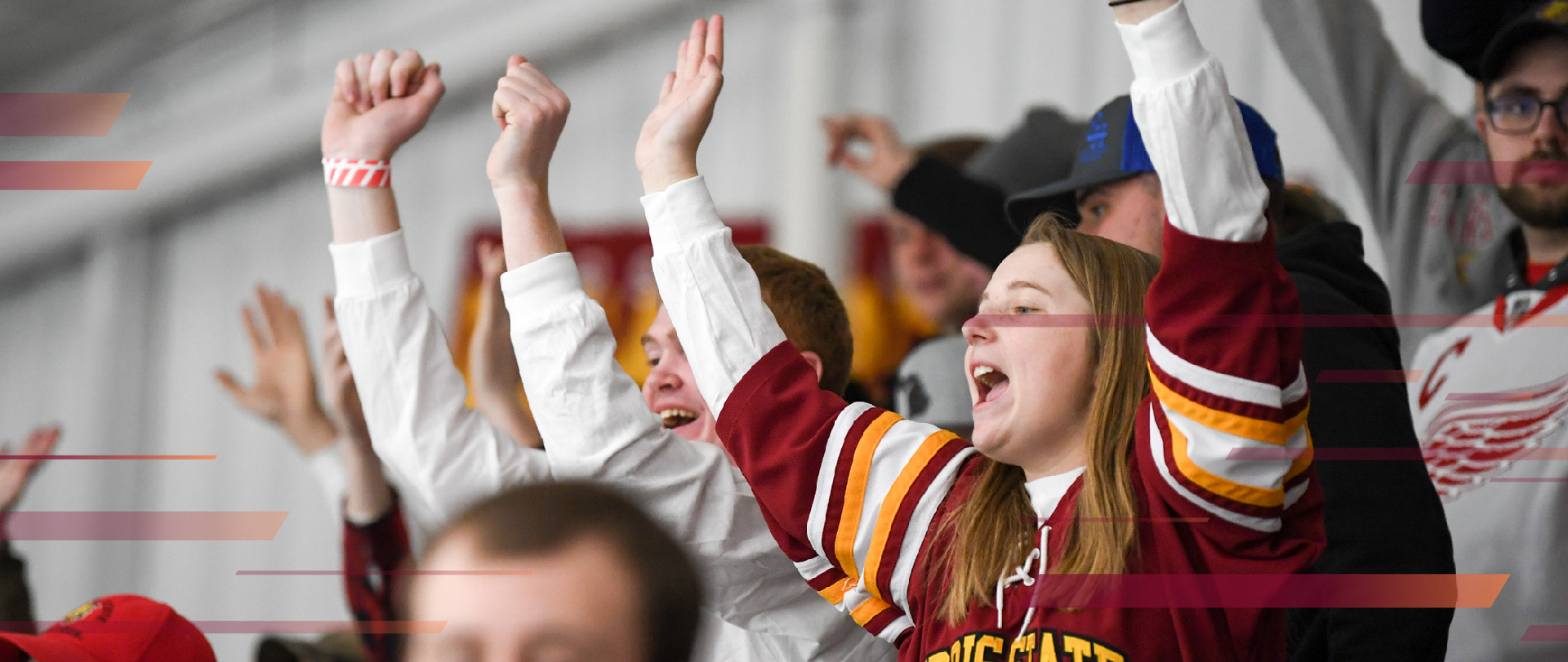 Students cheering for the Ferris hockey team